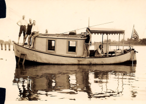 Olin (far left) and Mabel (seated under the awning) on their boat with friends, Willamette River, 1929