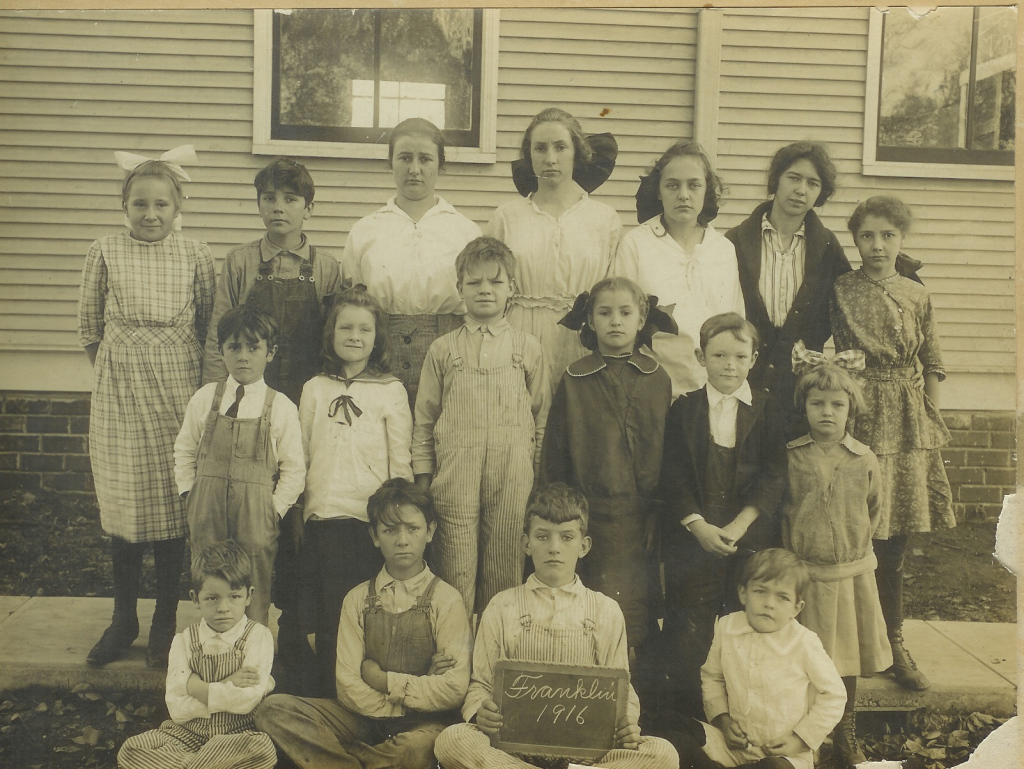 The Whitelaw children at the one-room Franklin School, Lawrence, Kansas, 1916. John, my father, is seated at the far left. His sister, Eleanor, is in the second row, second from left, and his brother, Neill, is on her left.