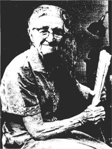 Bertha Bell Whitelaw, age 90, holding a newspaper for which she had recently written an article. (Goodell, 1962)