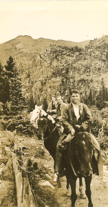 John horseback riding in the Rockies, mid 1930s. (His sister, Eleanor, is at the far back.)