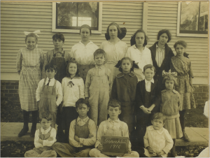 Franklin School, near Lawrence, Kansas, 1916. John is seated at lower left. Eleanor and Neill are in the second row, second and third from left.