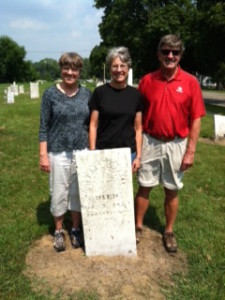 Susan, Nancy and John Whitelaw at the gravestone of Michael Duval, the father of Marcellisse Duval Goulet. St. Antoine Old Burying Ground, Monroe, MI. 2011.