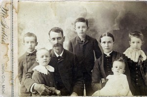 Love Family, 1886, Michigan. Left to right: Ralph, Lewis, George, Charles, Hanna, Olin, Ruth.