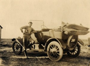 Olin Love and his car, about 1918.
